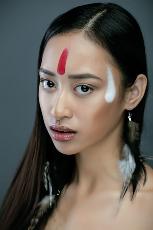 pocahontas: beauty young asian girl with make up like Pocahontas, red indians woman long hair vietnameese Stock Photo