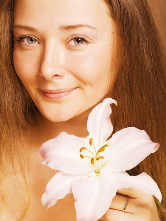 beauty young woman with flower close up getting spa photo