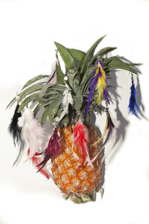 pineapple tree: pineapple like christmas tree with toys in feather earrings isolated
