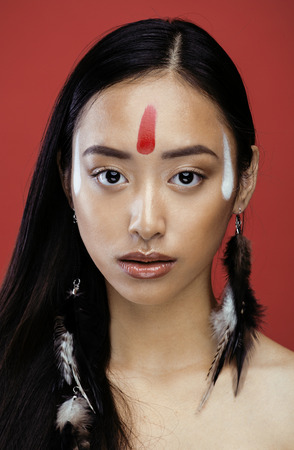 pocahontas: beauty young asian girl with make up like Pocahontas, red indians woman fashion, close up beauty