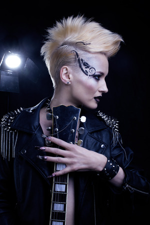spiked hair: Fashion Rocker Style Model Girl Portrait. Hairstyle. Rocker or Punk Woman Makeup, Hairdo and black Nails. Smoky Eyes