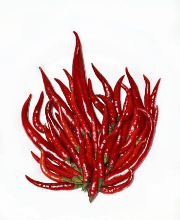 flame like: red hot chili peppers like a burning flame fire isolated on white