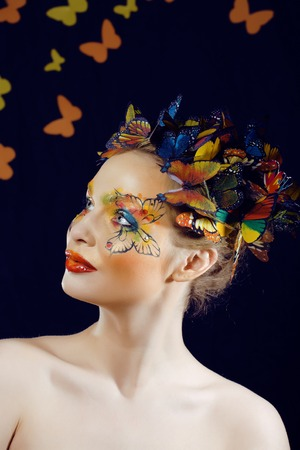 woman with summer creative make up like fairy butterfly closeup bright colored photo