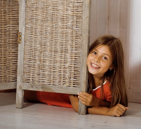 7 9 years: real little cute brunette girl at home smiling close up, real interior