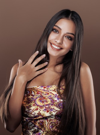 bronzed: cute happy young indian woman in studio close up smiling, fashion mulatto smiling