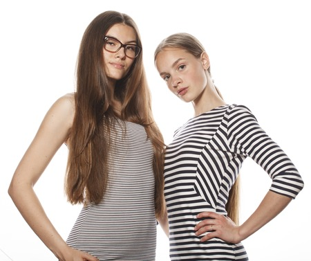 same: two young workers isolated on white, wearing same dresses in strip, glasses