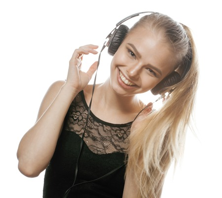 talented: young sweet talented teenage girl in headphones singing isolated Stock Photo