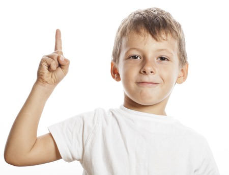 one child: little cute white boy pointing in studio isolated close up