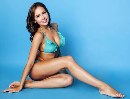 sexy boobs: young pretty brunette girl in bikini smiling studio close up