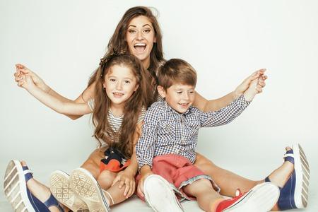 白、幸せな笑顔の家族内で 2 人の子供を持つ若い母親 写真素材
