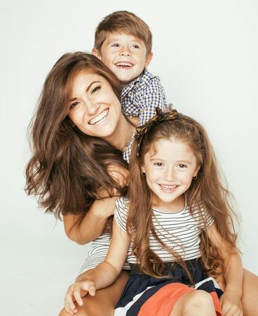 mother and children: madre joven con dos ni�os en blanco, familia sonriente feliz en el interior