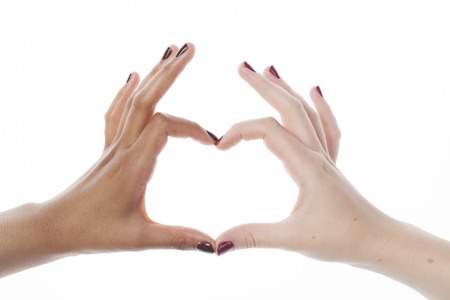 manicured hands: two different nathion manicured hands on white isolated, african with caucasian Stock Photo