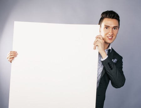 handsom: young handsom businessman in suit with poster empty copy space smiling Stock Photo