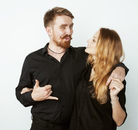 fooling: young hipster couple fooling around on white background close up Stock Photo