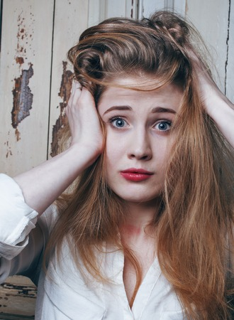junky: problem depressioned teenage with messed hair and sad face, real junky close up Stock Photo