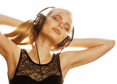 talented: young sweet talented teenage girl in headphones singing isolated close up