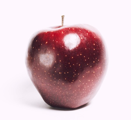 glossiness: attractive teasing red apple close up isolated on white background Stock Photo