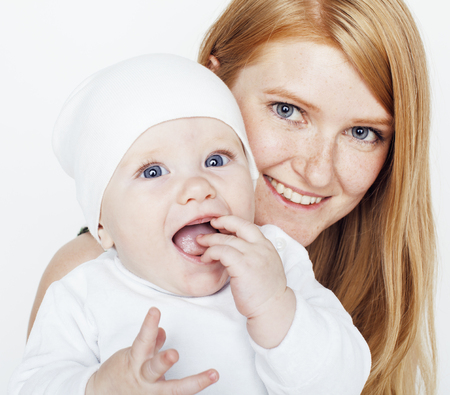 red head: young beauty mother with baby, red head happy family isolated close up Stock Photo