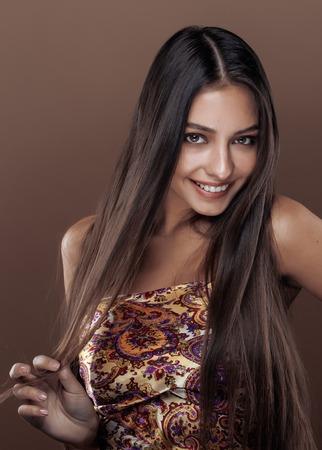 mulatto: cute happy young indian woman in studio close up smiling, fashion mulatto smiling adorable