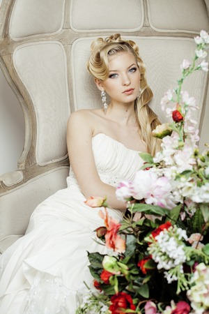 sexy bride: beauty young bride alone in luxury vintage interior with a lot of flowers close up, bridal style wedding Stock Photo