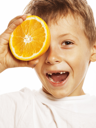 front teeth: little cute boy with orange fruit double isolated on white smiling without front teeth adorable kid