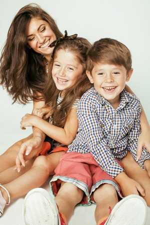 family portrait: young mother with two children on white, happy smiling family inside close up Stock Photo