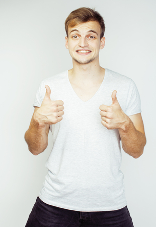 cute guy: young handsome man on white background gesturing, pointing, posing emotional, cute guy