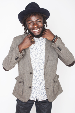 young handsome man: young handsome afro american boy in stylish hipster hat gesturing emotional isolated on white background