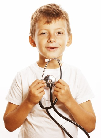 stethoscope boy: little cute boy with stethoscope playing like adult profession doctor close up smiling isolated on white