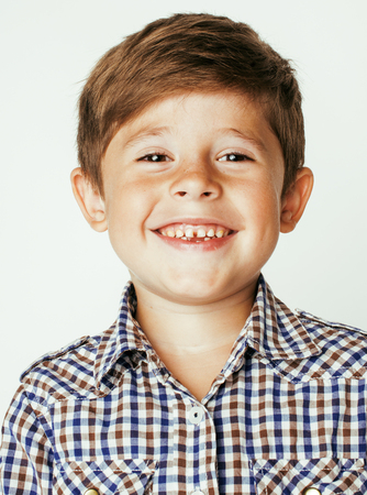 little cute boy on white background gesture smiling close up