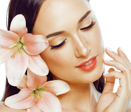 young attractive lady close up with hands on face