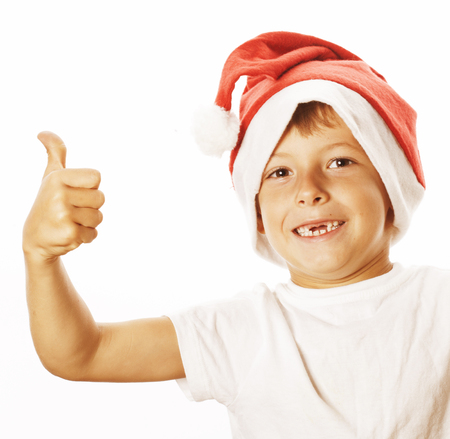 front teeth: little cute boy in santas red hat isolated  thumbs up happy kid without front teeth