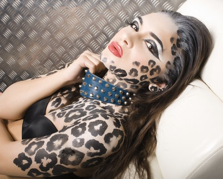 sexy girls party: young sexy woman with leopard make up all over body, cat bodyart closeup sensual Stock Photo