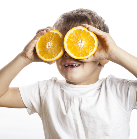 front teeth: little cute boy with orange fruit double isolated on white smiling without front teeth adorable kid cheerful