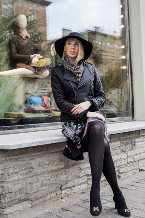 stylish women: young pretty blond woman in stylish hat, street fashion european cold weather, city life holiday