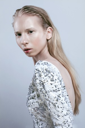 blooded: young blonde teenage girl with blooded lips, fashion dressed model, studio shot, shining white skin