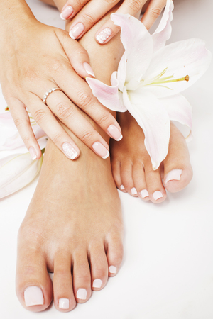 manicure pedicure with flower lily close up isolated on white perfect shape hands feet spa