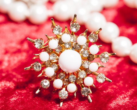 perl: lot of jewellery close up in red velvet box, ring bracelet with perl, celebration decoration, star card Stock Photo