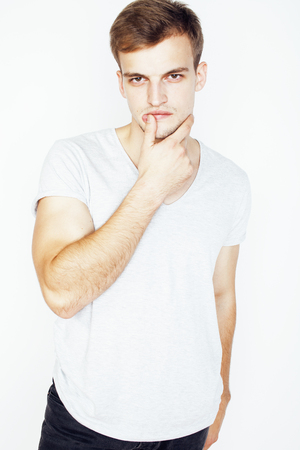 cute guy: young handsome man on white background gesturing, pointing, posing emotional, cute guy sexy Stock Photo