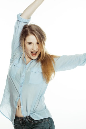 slovenly: cute young woman making cheerful faces on white background, messed hair isolated smiling