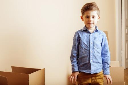 furniture concept: little cute boy in empty room