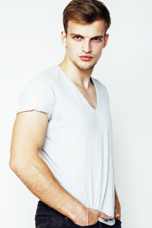hombres guapos: joven apuesto hombre sobre fondo blanco Foto de archivo