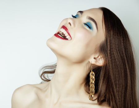 crimp: young pretty brunette woman close up smiling