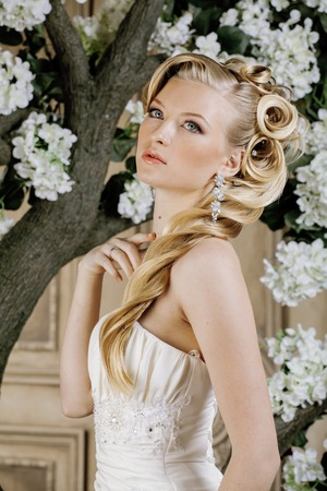 natural make up: beauty young bride alone in luxury vintage interior with a lot of flowers close up. stylish fashion hairstyle, natural make up