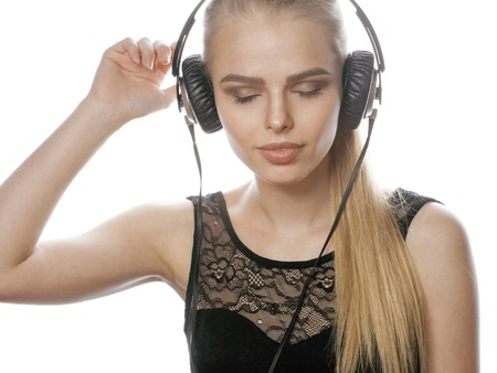 talented: young sweet talented teenage girl in headphones singing isolated on white, listening music concept