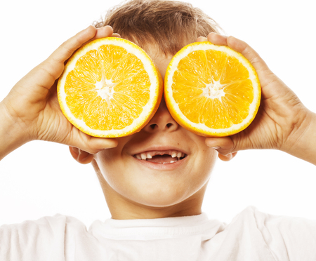 front teeth: little cute boy with orange fruit double isolated on white smiling without front teeth adorable kid cheerful close up Stock Photo