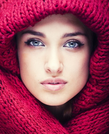 only 1 woman: young pretty woman in sweater and scarf all over her face, soft lips close up