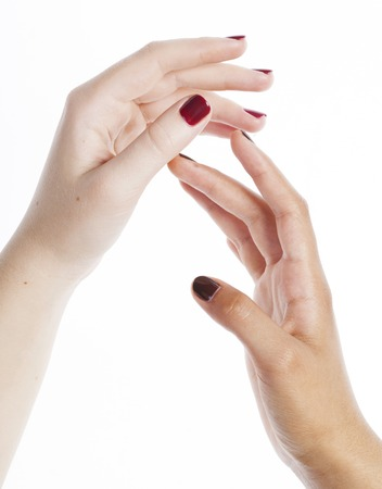 manicured hands: two different nathion manicured hands on white isolated, african with caucasian close up gesturing concept
