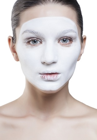 mummery: young pretty woman with facial white mask isolated close up spa concept Stock Photo