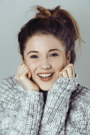 messed: beauty young real woman in sweater at winter warmed up, cheerful smiling closeup, cute girl messed hair Stock Photo